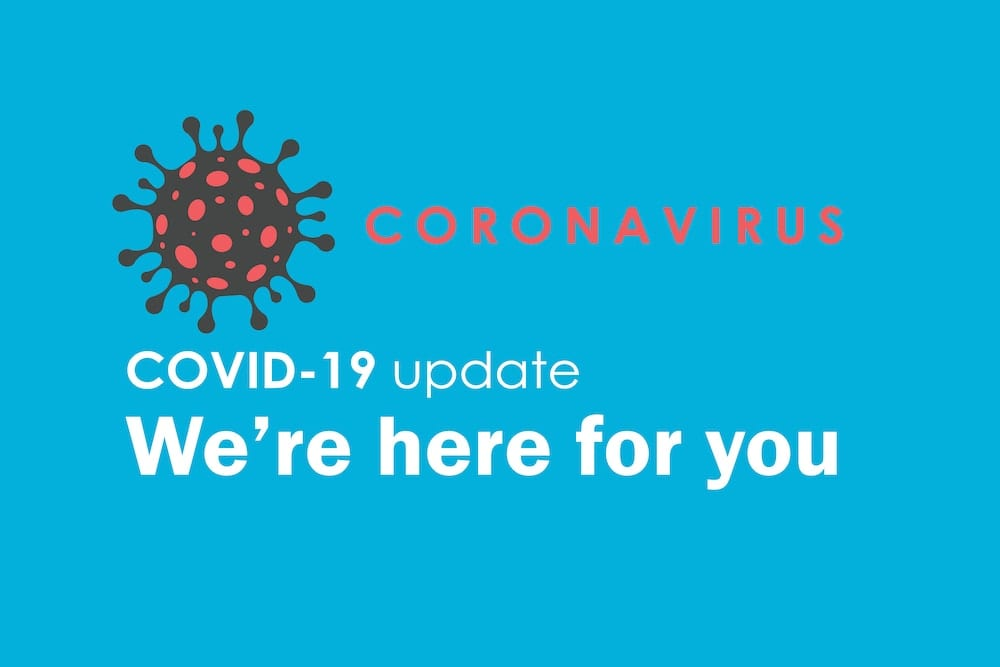 COVID sign, we're open and here for you.