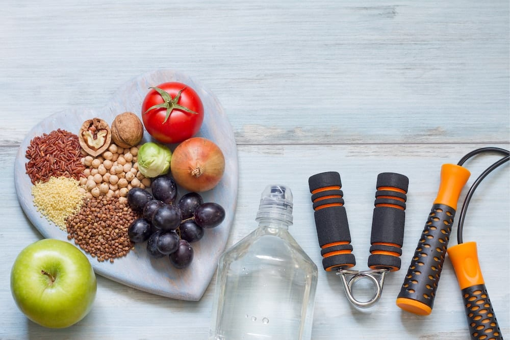 Image showing healthy snacks and exercise equipment. Materials needed for healthy lifestyle.